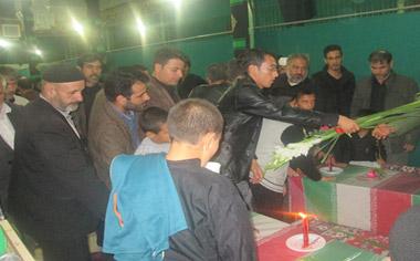 مراسم وداع با پیکرهای مطهر شهدای گمنام در شهر قهاوند برگزار شد